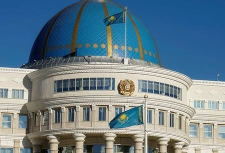 National flags and emblem are seen on Akorda, the official residence of Kazakhstan's President, in Astana, Kazakhstan, September 4, 2016. REUTERS/Shamil Zhumatov