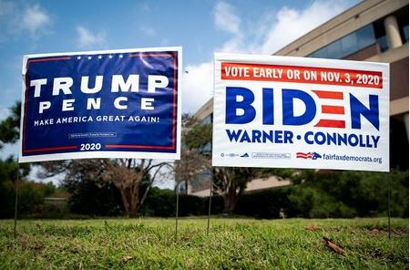 Yard signs supporting U.S. President Donald Trump and Democratic U.S. presidential nominee and former Vice President Joe Biden are seen outside of an early voting site at the Fairfax County Government Center in Fairfax, Virginia, U.S., September 18, 2020. REUTERS/Al Drago/File Photo