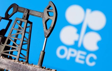 FILE PHOTO: A 3D printed oil pump jack is seen in front of displayed Opec logo in this illustration picture, April 14, 2020. REUTERS/Dado Ruvic/Illustration/File Photo