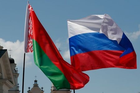 Belarusian and Russian national flags fly during