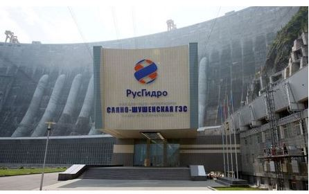 A logo of the RusHydro company, that operates the Russia's largest hydroelectric power station, Sayano-Shushenskaya, is seen above an entrance of the station, near the Siberian village of Cheryomushki, in the Republic of Khakassia, Russia July 22, 2019. Picture taken July 22, 2019. REUTERS/Ilya Naymushin
