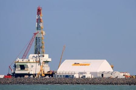 A drill rig under construction is seen at an offshore island in the northern Caspian Sea, part of the Kashagan oilfield, October 11, 2012. Up to 12 billion barrels of oil, enough to supply the world for four months, lie in wait beneath Kazakhstan's portion of the Caspian Sea, to be extracted by the consortium that includes ExxonMobil, Shell and Eni. But some in the seven-member development consortium are wondering whether they will be able to recoup their investment in the western Kazakh oil field before the current Production Sharing Agreement expires in 2041. Picture taken October 11, 2012. REUTERS/Robin Paxton (KAZAKHSTAN - Tags: ENERGY BUSINESS CONSTRUCTION)