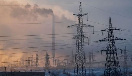 Power transmission lines are seen on a frosty day outside the town of Monchegorsk in Murmansk region, Russia October 31, 2019. REUTERS/Maxim Shemetov