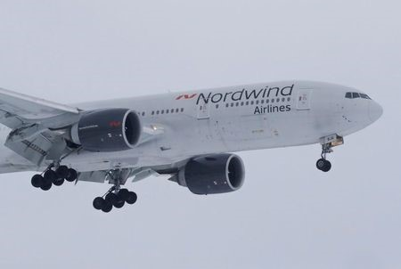 A Boeing 777 plane owned by Russia's Nordwind Airlines descends before landing and completing a direct flight from the Venezuelan capital of Caracas at Vnukovo International Airport outside Moscow, Russia January 31, 2019. REUTERS/Tatyana Makeyeva
