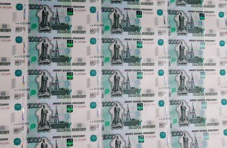 FILE PHOTO: A sheet of 1000 Russian Rouble notes at Goznak printing factory in Moscow, Russia July 11, 2019. REUTERS/Maxim Shemetov/File Photo