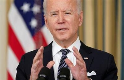 U.S. President Joe Biden speaks about the implementation of the American Rescue Plan in the State Dining Room at the White House in Washington, U.S., March 15, 2021. REUTERS/Kevin Lamarque
