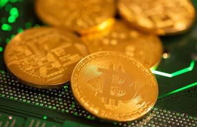 Representations of virtual currency Bitcoin are placed on a computer motherboard in this illustration taken January 21, 2021. REUTERS/Dado Ruvic/Illustration