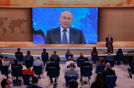 Journalists attend Russian President Vladimir Putin's annual end-of-year news conference, held online in a video conference mode, in Moscow, Russia December 17, 2020. REUTERS/Maxim Shemetov