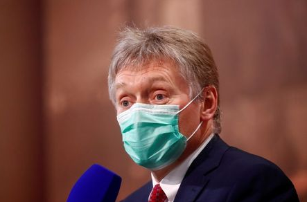 Kremlin spokesman Dmitry Peskov wearing a protective face mask attends Russian President Vladimir Putin's annual end-of-year news conference, held online in a video conference mode, in Moscow, Russia December 17, 2020. REUTERS/Maxim Shemetov