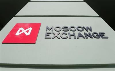 Moscow Exchange's logo is displayed outside its office in the capital Moscow, March 14, 2014. Russian stock indexes plunged to the lowest levels since 2009 on Friday, two days before a referendum in Crimea that is expected to provoke western sanctions against Russia. At 0745 GMT the MICEX stock index was down 4.6 percent at 1,191 points after falling more than 5 percent to reach its lowest point since October 2009, while the dollar-denominated RTS index had fallen 5.1 percent to 1,023 points, the lowest since August 2009. REUTERS/Maxim Shemetov (RUSSIA - Tags: BUSINESS LOGO POLITICS)