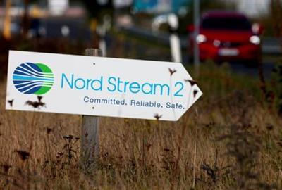 FILE PHOTO: A road sign directs traffic towards the Nord Stream 2 gas line landfall facility entrance in Lubmin, Germany, September 10, 2020. REUTERS/Hannibal Hanschke/File Photo