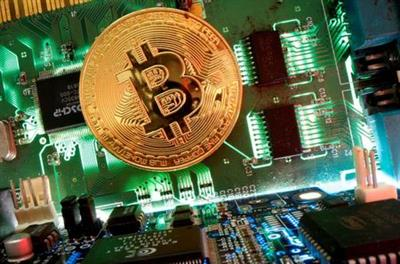 FILE PHOTO: Representation of the virtual currency Bitcoin is seen on a motherboard in this picture illustration taken April 24, 2020. REUTERS/Dado Ruvic/Illustration/File Photo/File Photo/File Photo