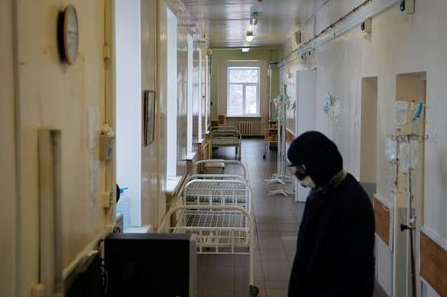 A medical specialist wearing protective gear is seen in the corridor of the Vologda City Hospital Number 1, where patients suffering from the coronavirus disease (COVID-19) are treated, in Vologda, Russia November 24, 2020. REUTERS/Anton Vaganov