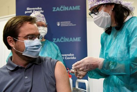 FILE PHOTO: Slovakia's Health Minister Marek Krajci receives an injection with a dose of Pfizer-BioNTech COVID-19 vaccine at the University Hospital, as the coronavirus disease (COVID-19) outbreak continues, in Nitra, Slovakia, December 26, 2020. REUTERS/Radovan Stoklasa/File Photo