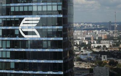 The logo of VTB Group is seen through a window of Imperia Tower on a facade of the Federatsiya (Federation) Tower at the Moscow International Business Center also known as