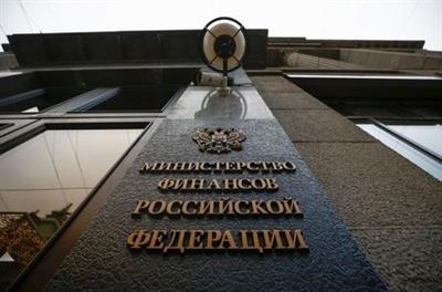 A sign is on display outside Russia's Finance Ministry building in Moscow, Russia March 30, 2021. A sign reads:
