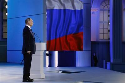 Russian President Vladimir Putin listens to the national anthem after delivering his annual address to the Federal Assembly in Moscow, Russia April 21, 2021. Sputnik/Mikhail Metzel/Kremlin via REUTERS ATTENTION EDITORS - THIS IMAGE WAS PROVIDED BY A THIRD PARTY.