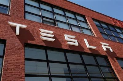 The TESLA logo is seen outside a dealership in the Brooklyn borough of New York City, U.S., April 26, 2021. REUTERS/Shannon Stapleton