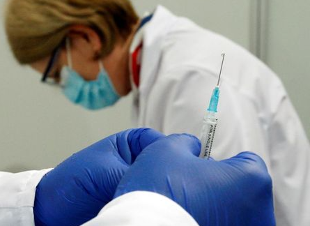 A nurse prepares a dose of Russia's Sputnik V coronavirus disease (COVID-19) vaccine at a sport centre, as the country starts mass inoculation campaign with the Russian vaccine donated by Serbia, in Skopje, North Macedonia April 5, 2021. REUTERS/Ognen Teofilovski