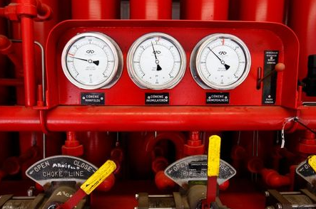 Pressure gauges are seen at a shale gas fracking facility belonging to Poland's PGNiG near the village of Rybakowo, May 21, 2013. Hopes that Poland could lead a U.S.-style shale gas boom in Europe are fading fast as energy companies say red tape is delaying commercial output and Warsaw's draft proposals to cut bureaucracy do not go nearly far enough. Picture taken May 21, 2013. REUTERS/Peter Andrews (POLAND - Tags: BUSINESS POLITICS ENERGY)