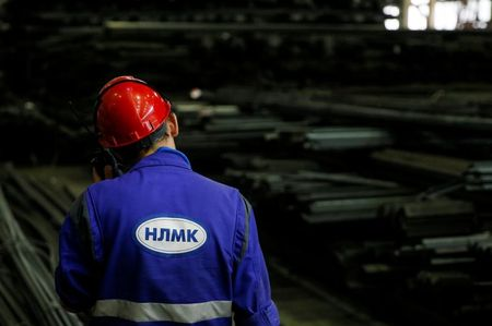 An employee speaks on a walkie talkie at a warehouse of the NLMK Kaluga steel mill in Vorsino outside Kaluga, Russia, July 21, 2016. REUTERS/Maxim Shemetov