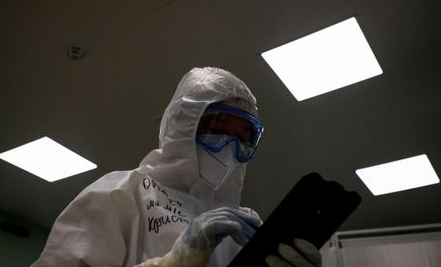 A medical specialist works inside a pavilion of the Exhibition of Achievements of National Economy (VDNH), which was converted into a temporary hospital for people suffering from the coronavirus disease (COVID-19), in Moscow, Russia November 17, 2020. Picture taken November 17, 2020. REUTERS/Maxim Shemetov