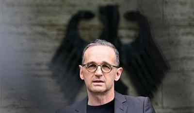 German Foreign Minister Heiko Maas gives a news conference in Berlin, Germany May 28, 2021 after Germany recognised for the first time that it had committed genocide in Namibia during its colonial occupation and agreed to fund projects worth over a billion euros. Tobias Schwarz/Pool via REUTERS