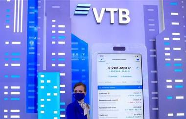 A participant wears a protective face mask at the stand of VTB bank during the St. Petersburg International Economic Forum (SPIEF) in Saint Petersburg, Russia, June 2, 2021. REUTERS/Evgenia Novozhenina