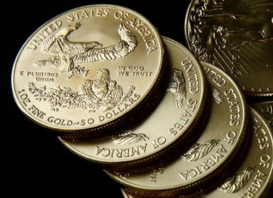 Gold U.S. dollar bullion coins are seen in this photo illustration taken in Moscow, Russia August 4, 2017. Picture taken August 4, 2017. REUTERS/Maxim Shemetov/Illustration