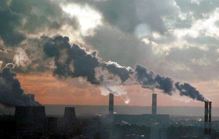 Smoke billows from the chimneys of a power station that produces heat and electricity in southern Moscow in this December 19, 2006 file picture. Russia has launched its first major energy awareness campaign since the fall of the Soviet Union in 1991, bringing an unfamiliar sight to Moscow's streets since the start of 2007 -- billboards urging citizens to switch to energy-saving light bulbs. To match feature RENEWABLE-ENERGY/MOSCOW REUTERS/Alexander Natruskin/Files (RUSSIA)