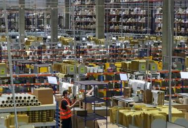 FILE PHOTO: An employee works at a logistics centre of the Yandex.Market e-commerce platform in Moscow, Russia June 21, 2021. Picture taken June 21, 2021. REUTERS/Evgenia Novozhenina/File Photo