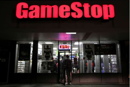 """People enter a GameStop store during """"Black Friday"""" sales in Carle Place, New York November 25, 2011. REUTERS/Shannon Stapleton"""