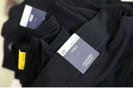Marks and Spencer (M&S) tags are seen on joggers made at the Fakhruddin Textile Mills Limited in Gazipur, Bangladesh, February 7, 2021. Picture taken February 7, 2021. REUTERS/Mohammad Ponir Hossain