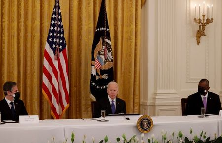 U.S. President Joe Biden is flanked by Secretary of State Antony Blinken and Defense Secretary Lloyd Austin as he holds a Cabinet meeting in the East Room at the White House in Washington, U.S., April 1, 2021. REUTERS/Tom Brenner