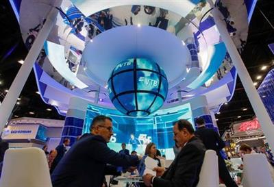 Participant are seen at the Russian VTB bank stand during the St. Petersburg International Economic Forum (SPIEF), Russia, June 6, 2019. REUTERS/Maxim Shemetov