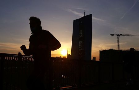 A runner passes the European Central Bank (ECB) headquarters during sunset as the spread of the coronavirus disease (COVID-19) continues in Frankfurt, Germany, April 8, 2021. REUTERS/Kai Pfaffenbach