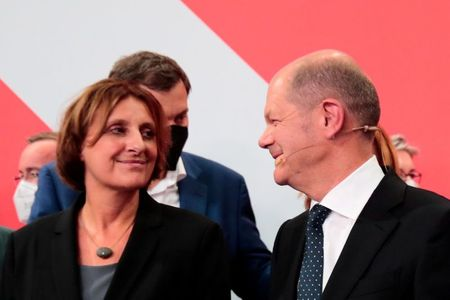 Social Democratic Party (SPD) top candidate for chancellor Olaf Scholz and his wife Britta Ernst react after first exit polls for the general elections in Berlin, Germany, September 26, 2021. REUTERS/Hannibal Hanschke