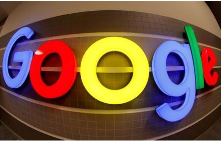 FILE PHOTO: FILE PHOTO: An illuminated Google logo is seen inside an office building in Zurich, Switzerland December 5, 2018. Picture taken with a fisheye lens. REUTERS/Arnd Wiegmann/File Photo/File Photo