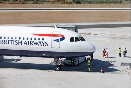 People board a British Airways airplane, as Croatia struggles with more cases of coronavirus disease (COVID-19), at the airport in Split, Croatia August 20, 2020. REUTERS/Antonio Bronic