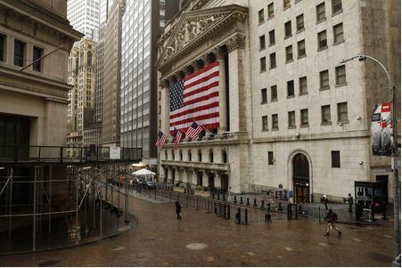 FILE PHOTO: S&P500 index United States flags fly outside of the New York Stock Exchange (NYSE) as markets continue to react to the coronavirus disease (COVID-19) at the NYSE in New York, U.S., March 19, 2020. REUTERS/Lucas Jackson