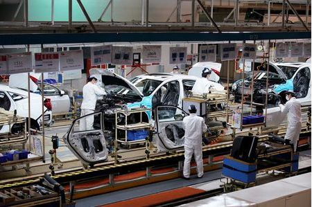 Employees work on a production line inside a Dongfeng Honda factory after lockdown measures in Wuhan, the capital of Hubei province and China's epicentre of the novel coronavirus disease (COVID-19) outbreak, were further eased, April 8, 2020. REUTERS/Aly Song