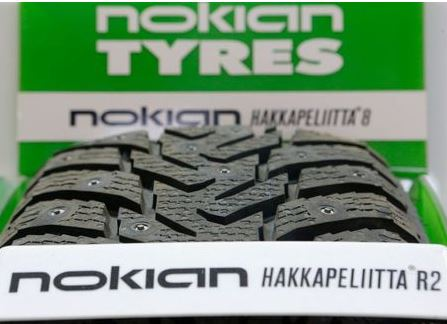 A Nokian tyre is on display at a tyre assembling centre and shop in Moscow, August 8, 2014. Finnish winter tyre maker Nokian Renkaat reported a bigger-than-expected fall in second-quarter operating profit due to plummeting sales in Russia. REUTERS/Maxim Shemetov (RUSSIA - Tags: BUSINESS TRANSPORT LOGO)