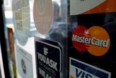 A sticker shows that a store accepts MasterCard in Harvard Square in Cambridge, Massachusetts, U.S., July 25, 2018. REUTERS/Brian Snyder