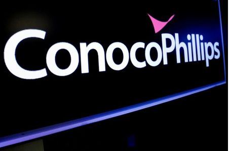 The logo for ConocoPhillips is displayed on a screen on the floor at the New York Stock Exchange (NYSE) in New York, U.S., January 13, 2020. REUTERS/Brendan McDermid