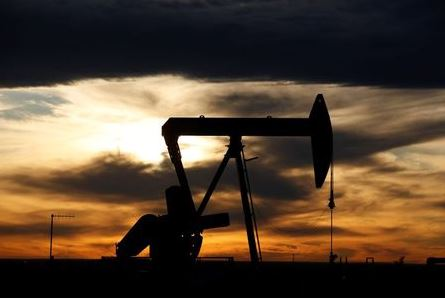 The sun sets behind a crude oil pump jack on a drill pad in the Permian Basin in Loving County, Texas, U.S. November 24, 2019. Picture taken November 24, 2019. REUTERS/Angus Mordant