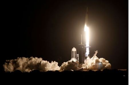 A SpaceX Falcon 9 rocket, with the Crew Dragon capsule, is launched carrying four astronauts on the first operational NASA commercial crew mission at Kennedy Space Center in Cape Canaveral, Florida, U.S. November 15, 2020. REUTERS/Thom Baur TPX IMAGES OF THE DAY
