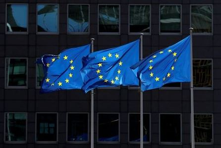 FILE PHOTO: European Union flags flutter outside the European Commission headquarters in Brussels, Belgium August 21, 2020. REUTERS/Yves Herman