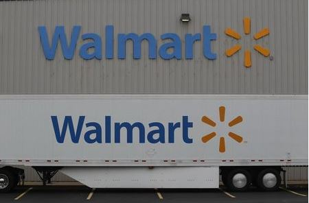 The Wal-Mart company logo is seen outside a Wal-Mart Stores Inc company distribution center in Bentonville, Arkansas June 6, 2013. REUTERS/Rick Wilking (UNITED STATES - Tags: BUSINESS)