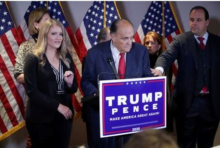 Trump Campaign Senior Legal Advisor Jenna Ellis speaks as Trump campaign advisor Boris Epshteyn reaches out to former New York City Mayor Rudy Giuliani, personal attorney to U.S. President Donald Trump, during a news conference about the 2020 U.S. presidential election results at Republican National Committee headquarters in Washington, U.S., November 19, 2020. REUTERS/Jonathan Ernst
