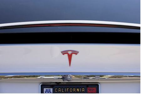 FILE PHOTO: A Tesla Model X is shown at a Tesla service center in Costa Mesa, California, U.S., October 20, 2020. REUTERS/Mike Blake/File Photo